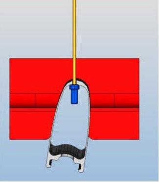Vrtání otvorů pro dráty. Kontrola excentrického vrtání ráfku pro optimalizaci výpletu.